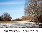 rolling hills covered with snow ... | Shutterstock . vector #576179524