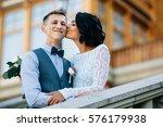bride kissing happy groom in... | Shutterstock . vector #576179938