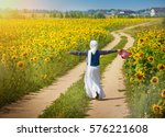 muslim woman on sunny sunflower ... | Shutterstock . vector #576221608
