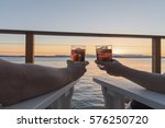 couple holding glasses up at... | Shutterstock . vector #576250720
