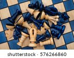 Small photo of Chess pieces strewn across the board close up