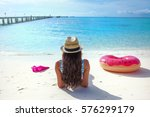 white sandy tropical beach ... | Shutterstock . vector #576299179