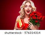beautiful blonde woman holding... | Shutterstock . vector #576314314