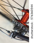 Small photo of abstract photo of rear anodized alum rear hub and nine speed cassette on a racing road bike