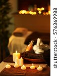 Small photo of Natural treatments and alight candles in spa salon