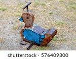 Old Rocking Horse In Playground