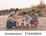 family playing on the beach | Shutterstock . vector #576440824