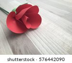 red rose made from paper on the ... | Shutterstock . vector #576442090