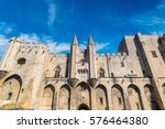 papal palace in avignon in a... | Shutterstock . vector #576464380