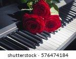 red roses on piano keys   Shutterstock . vector #576474184