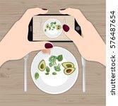 hands holding phone taking... | Shutterstock .eps vector #576487654