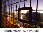 Stock photo looking at the las vegas strip sunset lights through the barrier on the eiffel tower january 576490630
