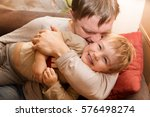 the father embraces the little...   Shutterstock . vector #576498274