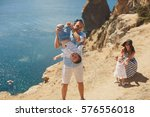 happy family of four walking in ...   Shutterstock . vector #576556018