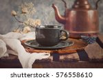 cup of hot coffee and a kettle... | Shutterstock . vector #576558610