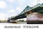 green steel bridge with blue sky   Shutterstock . vector #576561448