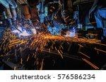 team robots are welding... | Shutterstock . vector #576586234
