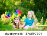 two cute little girls holding... | Shutterstock . vector #576597304