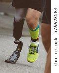 man running with prosthetic leg ... | Shutterstock . vector #576623584