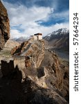 A small watchtower within the cliffs of Dhankar monastery overlooks Spiti Valley below. - stock photo