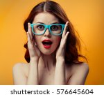 Woman In Glasses On A Orange...