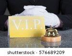 close up of a waiter hand near... | Shutterstock . vector #576689209