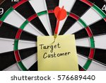Small photo of A Target Audience Concept Aimed With Arrow On Dartboard