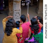"""Small photo of GUJARAT, INDIA - NOVEMBER 9, 2016: Unidentified group of young people posing for a group portrait, or """"selfie"""", using a """"selfie stick"""". Taking such photographs has become commonplace around the world"""