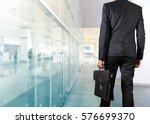 businessman holding a briefcase ... | Shutterstock . vector #576699370