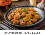 golden fried mini croquette... | Shutterstock . vector #576711166