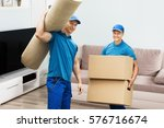portrait of a two male workers... | Shutterstock . vector #576716674