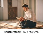 young adult muslim reading | Shutterstock . vector #576751996
