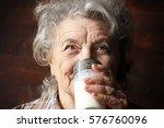 grandmother drinks a glass of...   Shutterstock . vector #576760096