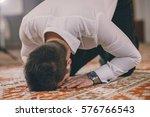 muslim praying  prostrating on... | Shutterstock . vector #576766543