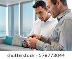 two focused male coworkers deep ...   Shutterstock . vector #576773044