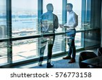 two businessmen deep in... | Shutterstock . vector #576773158