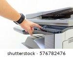 copier start   finger pressing... | Shutterstock . vector #576782476