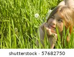 Girl with a Dandelion / in green meadow / freedom - stock photo