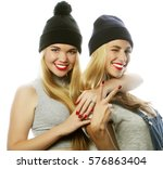 two young girl friends standing ... | Shutterstock . vector #576863404