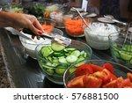 sorted fresh salads displayed...   Shutterstock . vector #576881500