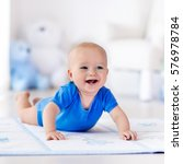 adorable baby boy learning to... | Shutterstock . vector #576978784