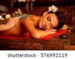 mud mask of woman in spa salon. ... | Shutterstock . vector #576992119