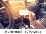 driver in car hold a blank... | Shutterstock . vector #577042936