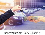 hand hold money and key car  ... | Shutterstock . vector #577045444
