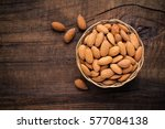 almonds in willow bowl against...   Shutterstock . vector #577084138