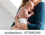 mother holding her newborn baby ... | Shutterstock . vector #577092190