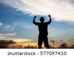 silhouette of man praying over... | Shutterstock . vector #577097410