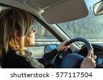 beautiful blonde driving a car | Shutterstock . vector #577117504