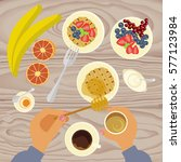 person is eating breakfast with ... | Shutterstock .eps vector #577123984