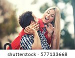 young happy couple is enjoying... | Shutterstock . vector #577133668